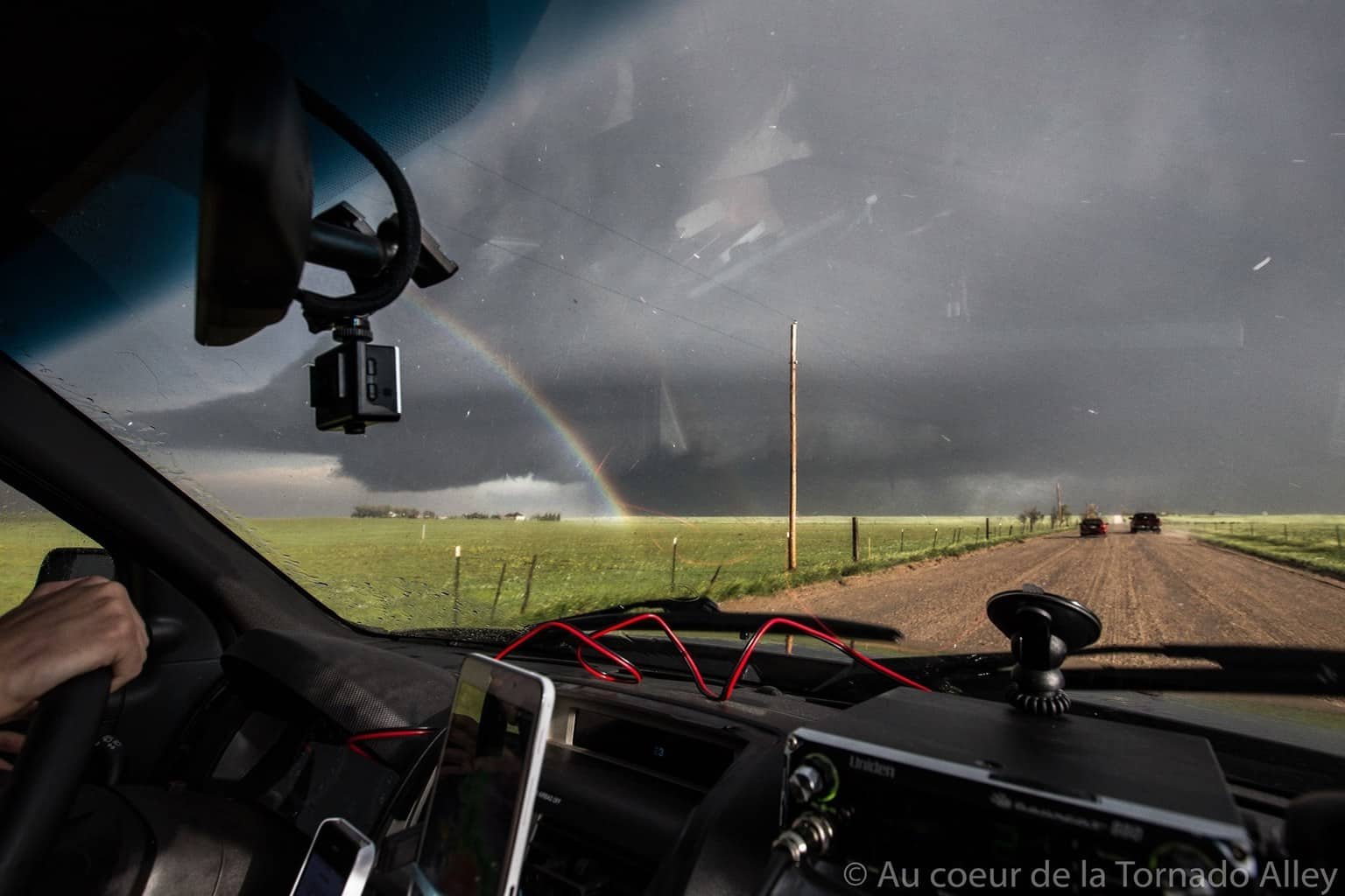 And yes, again the June 4th! Geez! I very like this pics because lots of thing are on her: Tornado, Rainbow, Supercell, other stormchaser, my great friend, the car... — with Francis Lavigne-theriault.
