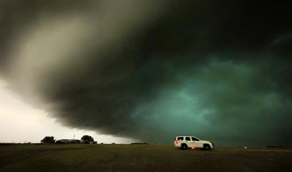 Massive tornado-warned storm right above us as police raced down the highway in Texas early May 2015.