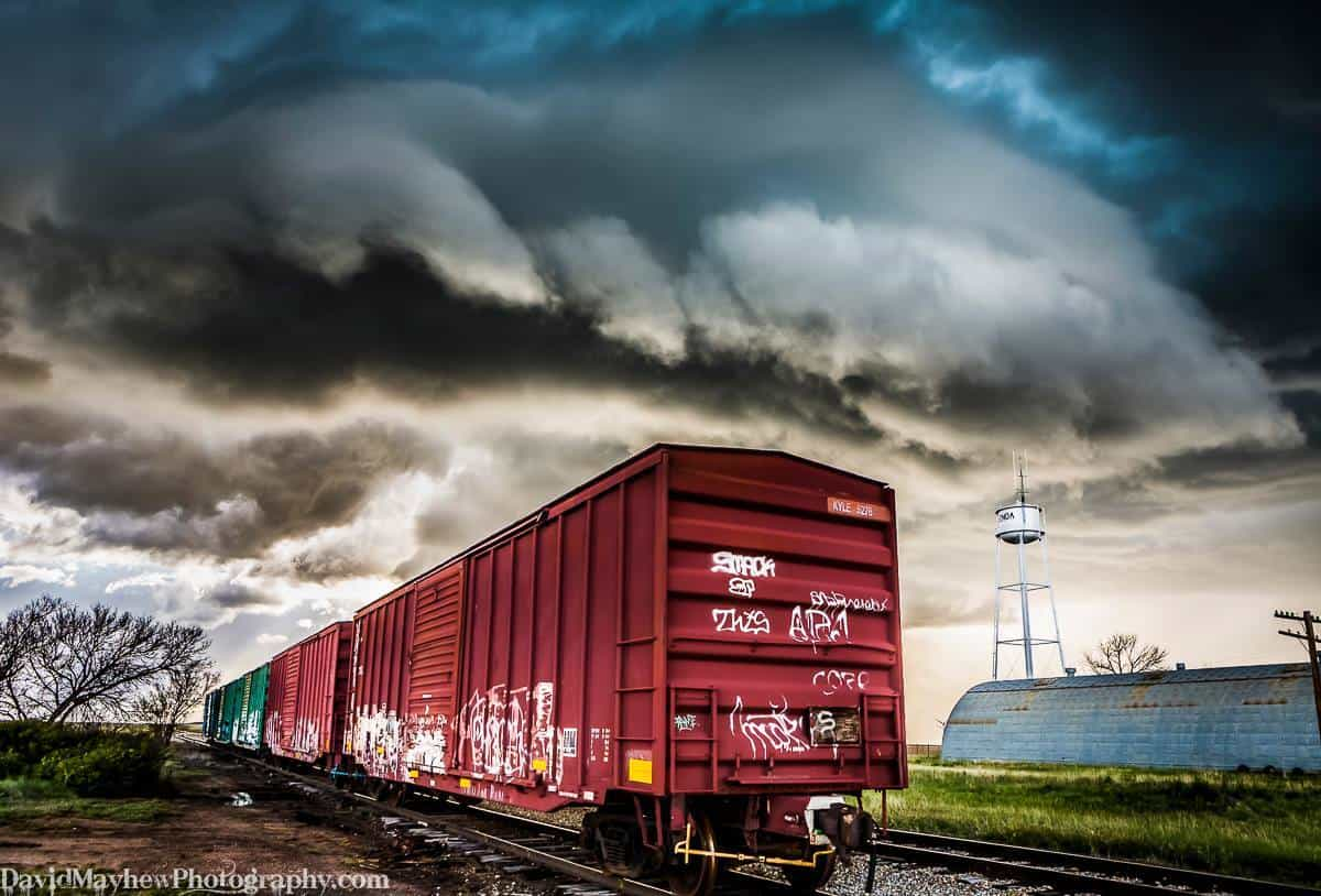 """""""Storm Manifest"""" A supercell storm shelf cloud approaches vibrant box cars in Eastern Colorado. Manifest is also a railway term for a freight train with a mixture of car types and cargoes. May 22nd 2015 Running this piece through initial test prints. It's a borderline photo for me, but it might just creep in as a piece I display."""