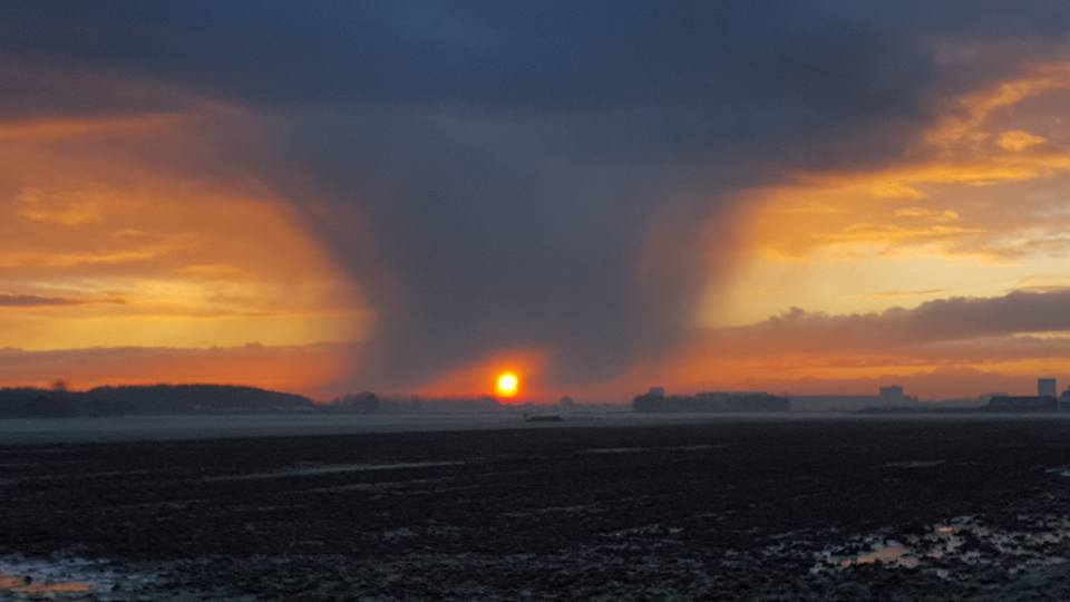 Ever seen this? Sun trough preciptation? Just now in the Netherlands...