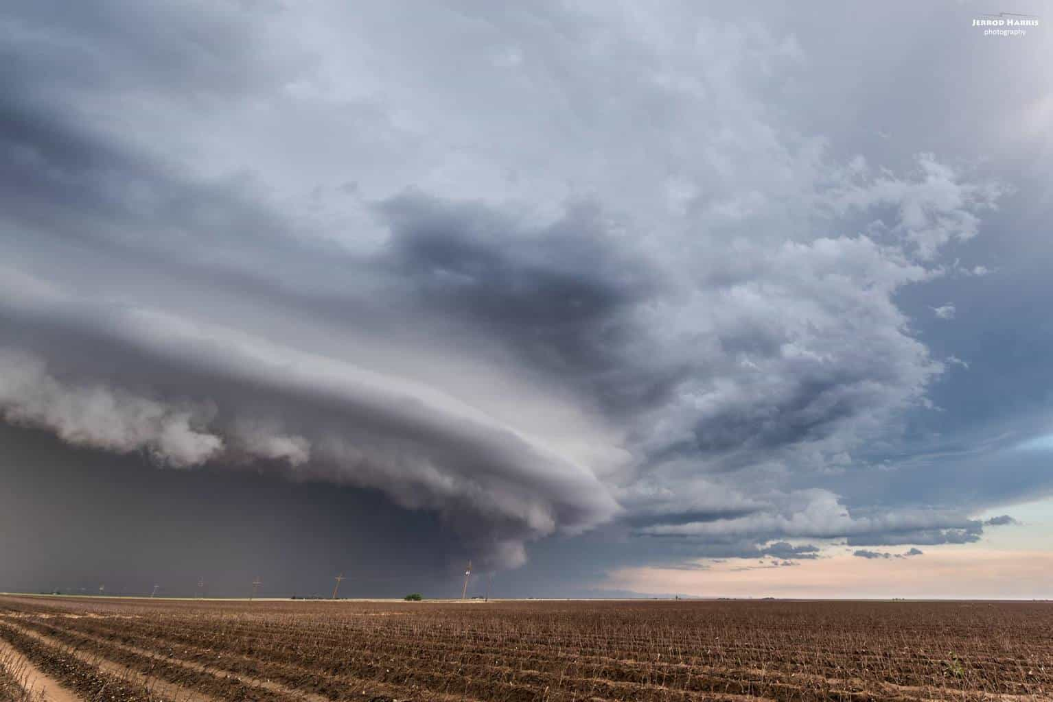 A shelf cloud stretches out across some freshly cleared fields moments after a tornado lifted in May of 2015 just south of Lubbock, TX.