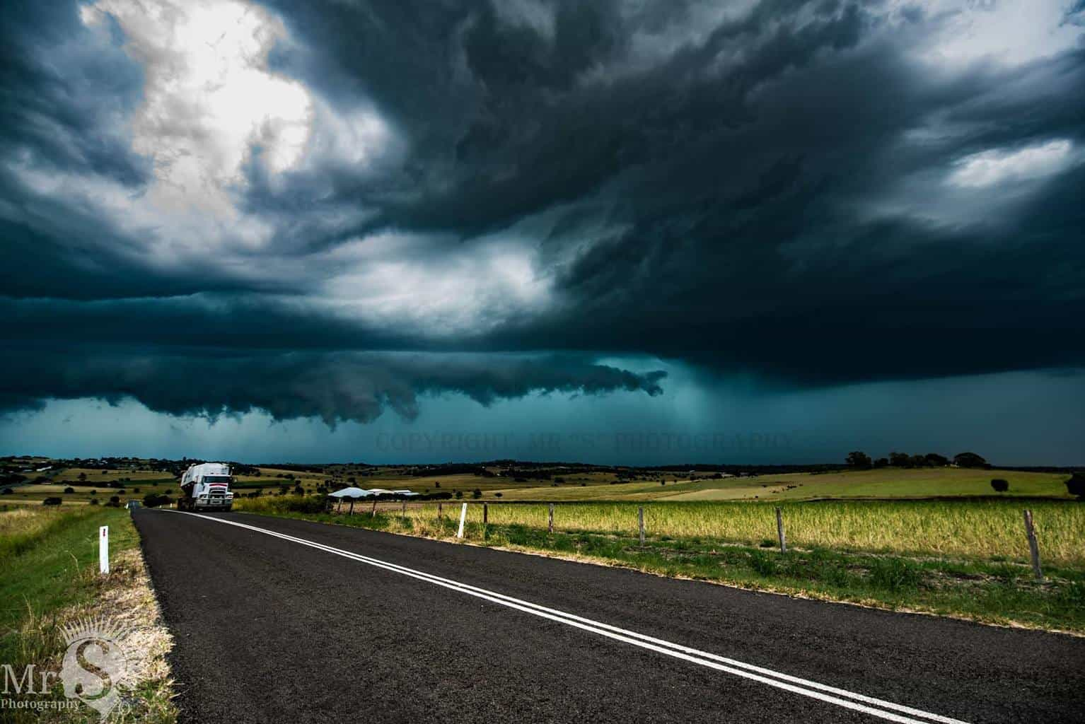 !! Keep on Truckin !! A truck passes by as it just avoids a severe warned cell as it approaches Boonah Qld Australia on the 29th Jan. It was a brilliant storm chase.