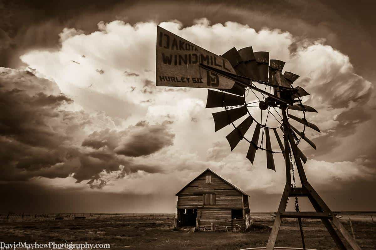 """May 20th 2014 Flagler CO (Don't be fooled by the weathervane branding!) A supercell storm moves East towards Kansas with an old barn and windmill in the foreground. Same storm as """"Cloud of Witnesses"""""""