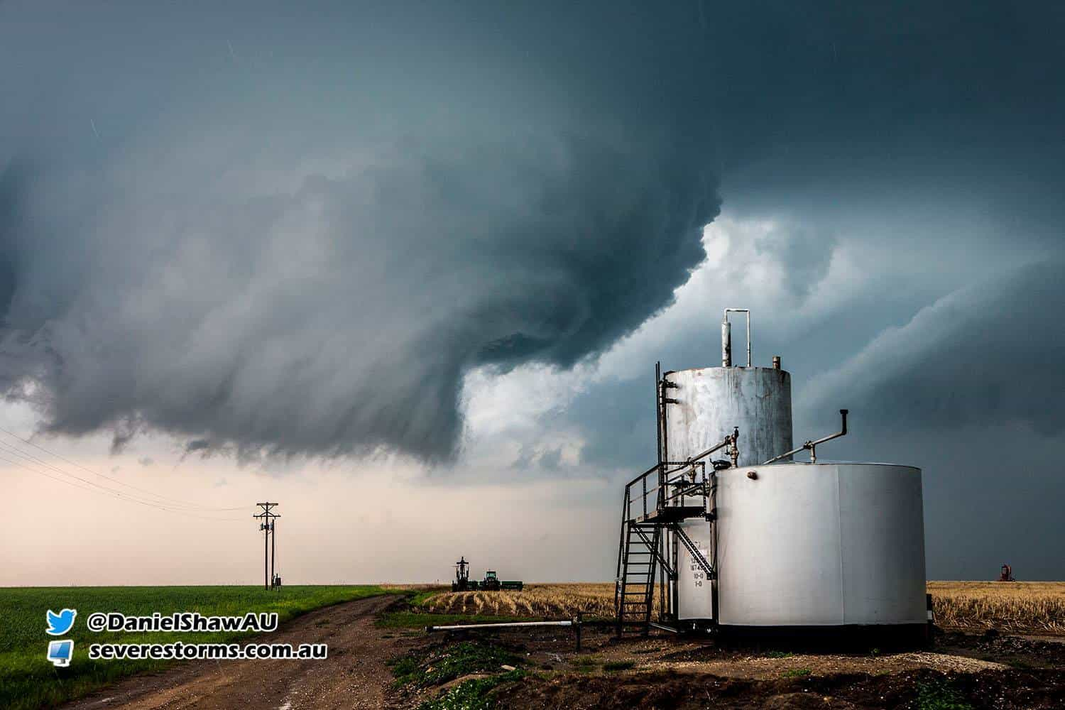 An almost stationary funnel starts to form over a silo in Kansas. May 2008