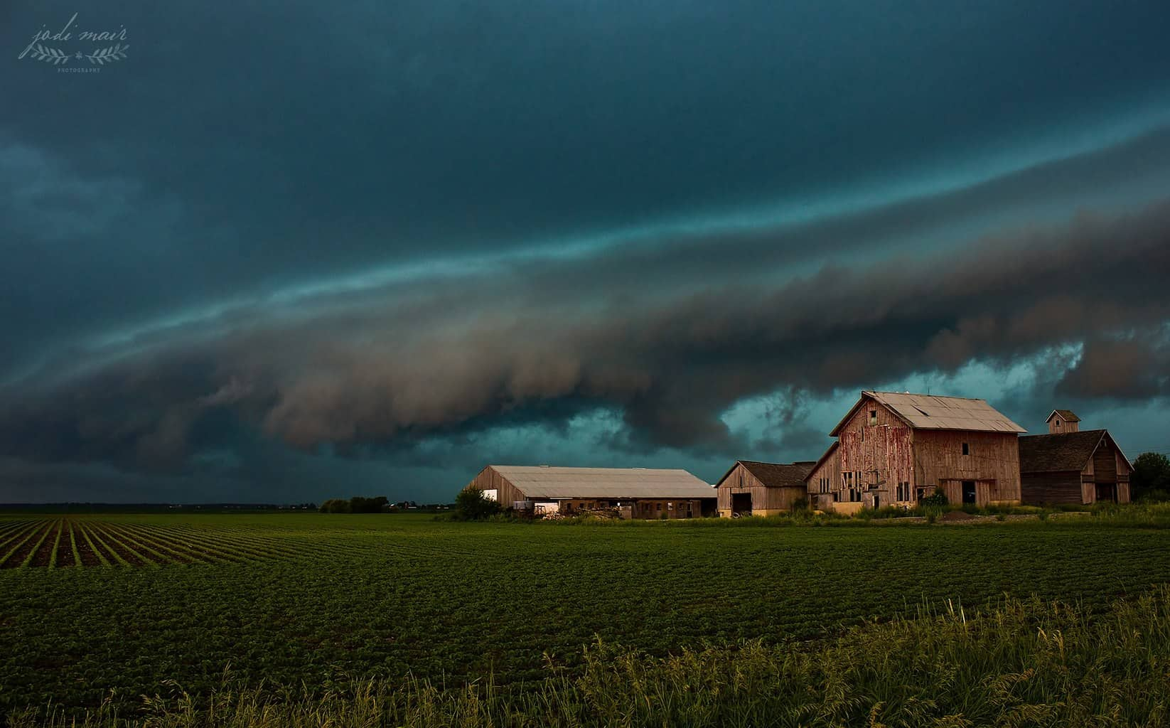 """As we are expecting another 3-5"""" of snow tonight/tomorrow in northern Illinois, I can't help but let my mind wander back to warmer days and stormier scenes. This is one of my most favorite photos ever from June 21, 2014 near Sugar Grove, Illinois. Sadly, these barns are no longer standing."""