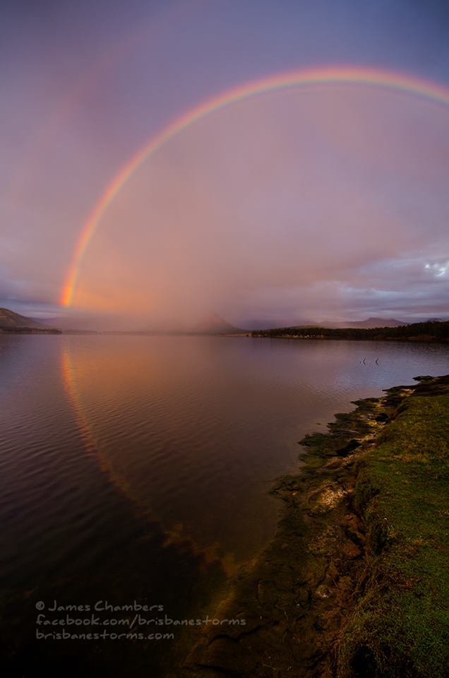 This beautiful rainbow appeared on what had been a rather miserable morning at Lake Moogerah, Australia in June 2015. The reflection making it looking 'larger' than your typical rainbow.