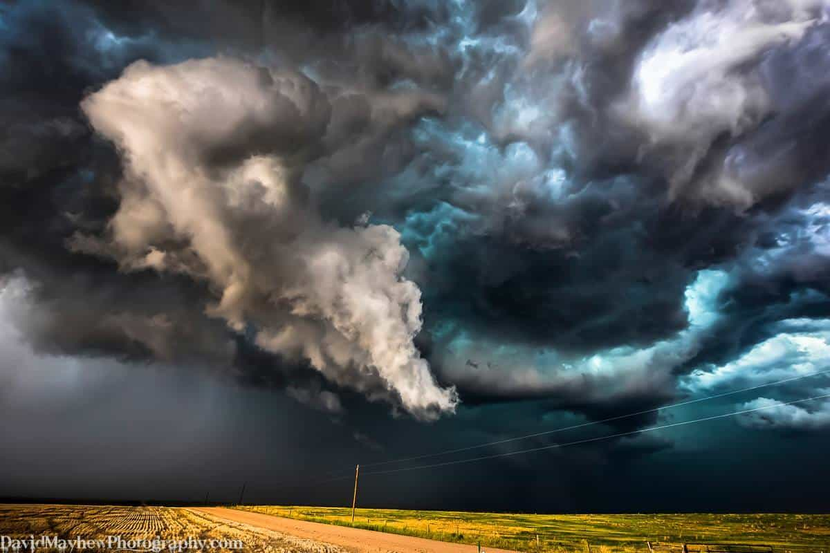 """""""Anticipation"""" A Northern Colorado storms builds up momentum as this protrusion rotates and lowers to the ground only to fade away as the storm rapidly collapses. It was so close and so exciting for a while, then """"poof"""" the whole storm collapsed and completely disappeared in about 15 minutes!"""