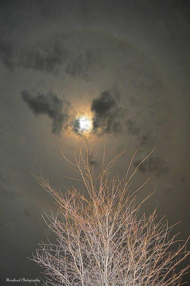 Last night's moon behind the clouds with a huge ring over Porter, Oklahoma