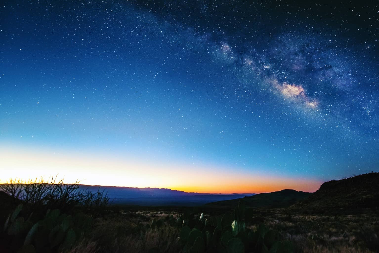 One of the harder photos I've shot in a while, the milky way with the sun starting to rise underneath. Big Bend, Texas.