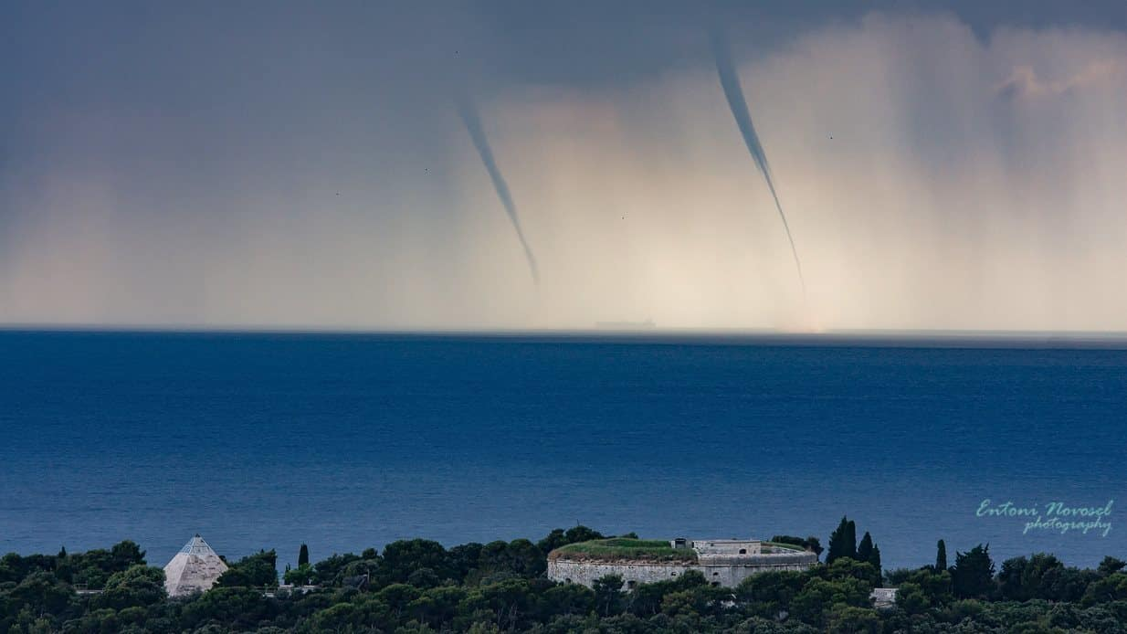 Two waterspouts and a funnel(even a ship in the distance),from a crazy outbreak that hit the Istrian coast in june 2013. (there were several other photos from a few friends and chasers on this page). There were more than 13 confirmed waterspouts that day,a once in a lifetime experience. In the bottom of the photo there are two buildings,a pyramid,a well known disco club( Piramida) in late '80s and during '90s and on the right Fort Bourguignon ,one of the 26 forts that the old Austro Hungarian empire built for military scopes in my town from 1813.-1918(sorry for a little bit of history  )