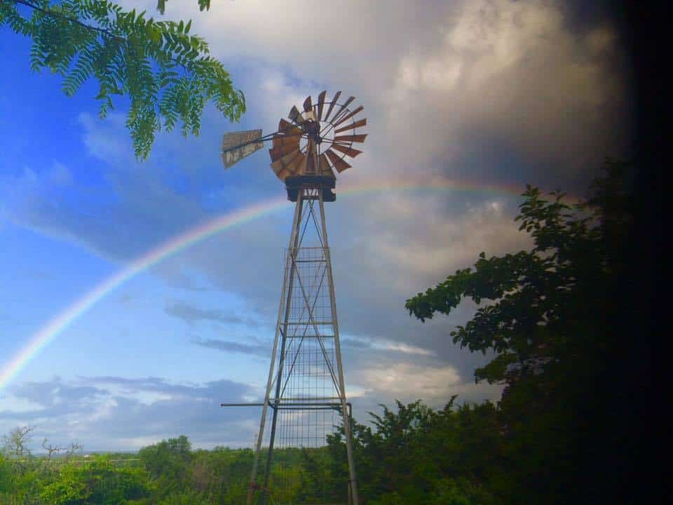 Taken this morning in Comfort TX. I was sitting on my front porch drinking coffee and enjoying a little rain shower when this rainbow appeared before my eyes. God is Great!