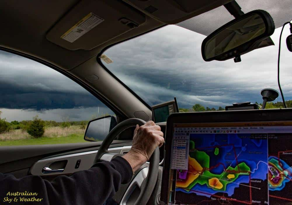 As the navigator and general computer nerd, this was my view for part of the chase today in northeast Texas..... 11th April, 2016 ...the arm is owned by our very able pilot and forecaster Clyve Herbert....and an out-the-window view pacing a Texas HP supercell.