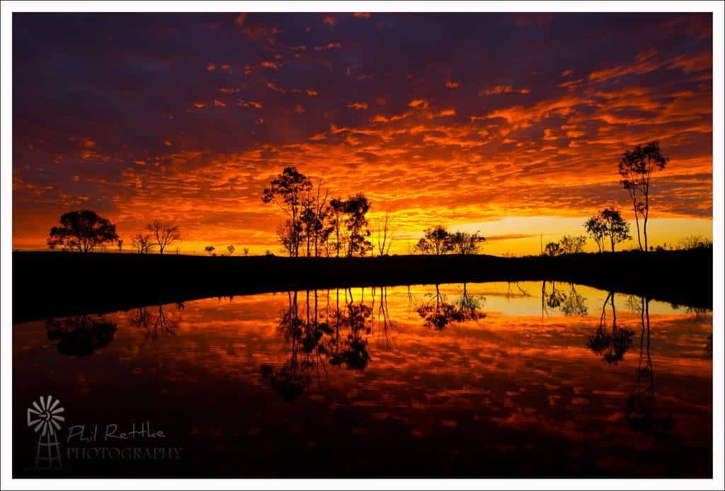 After a brief Summer storm passed the leftover clouds produced this fiery sunset near Ipswich in South East Queensalnd, Australia.
