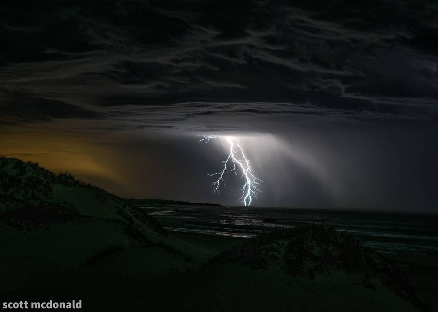 lightning strikes just of the coast as a storm sweeps over areas north of perth western australia last week
