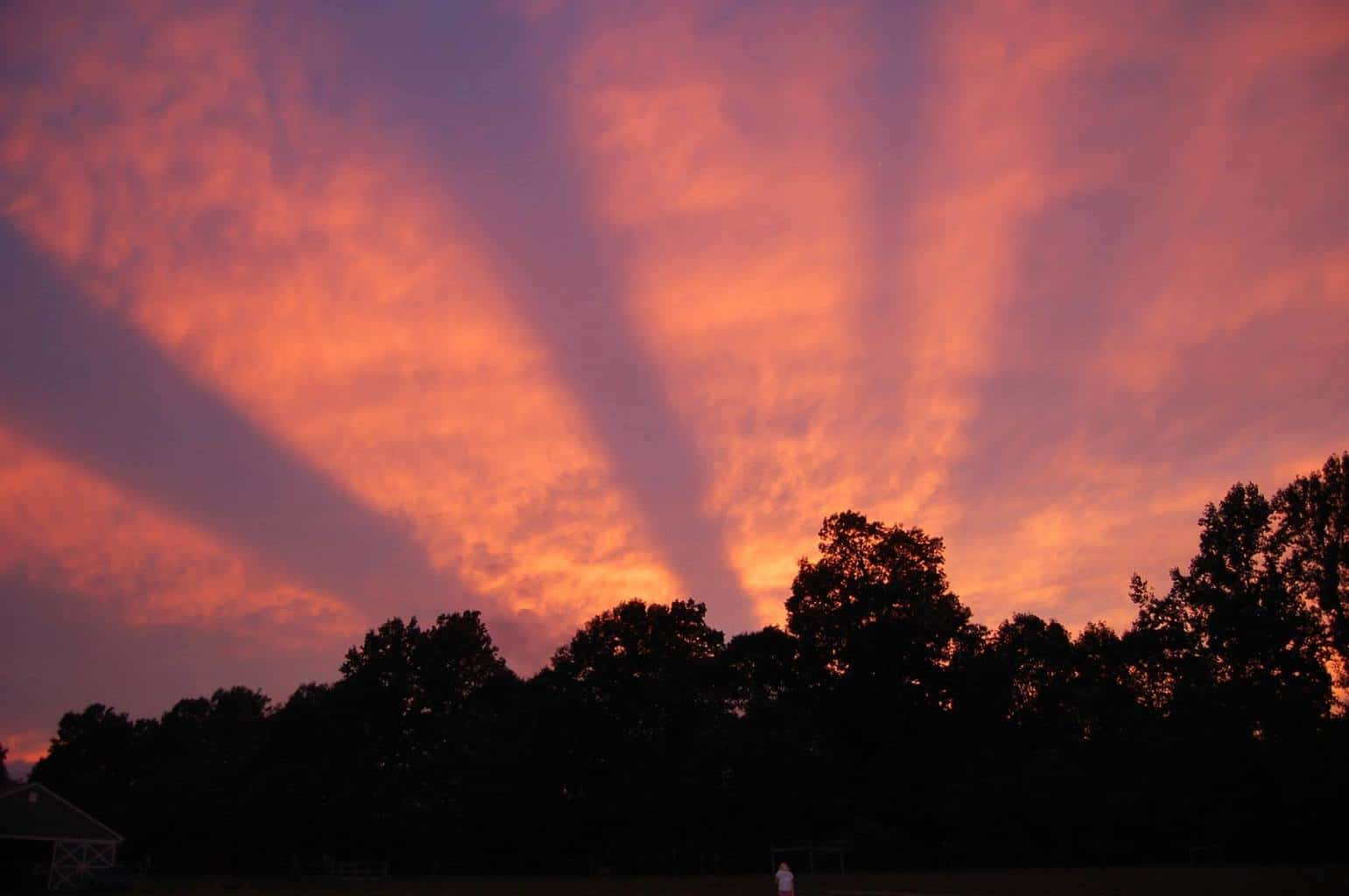 """Resurrection Celebration Because Jesus Lives!"" For several years I have wondered WHAT??!! created the stunning striped effect in the sky on the evening of 8/7/12. These stripes originated in the west, stretched overhead, and reached all the way into the east. To the best of my understanding smile emoticon, I learned they are called crepuscular rays (shadows actually) when the viewer is facing the sun. Had I faced east and taken a photo of these rays also stretching into that horizon, they would then be called anticrepuscular rays. In my photo, these rays of shadow are created either by: 1. the sun behind clouds obstructing the sun's light rays just at or below the horizon, OR MAY BE 2. the sun behind obstructing mountains in the distance behind my house? I'll see if I can post the computerized mountainscape..."