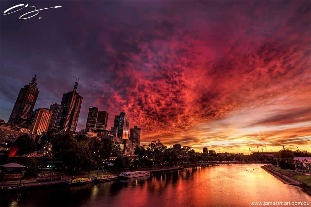 SKYLINE BLAZE As the sun rises over the MCG, the sky erupts with colour over Melbourne, Australia