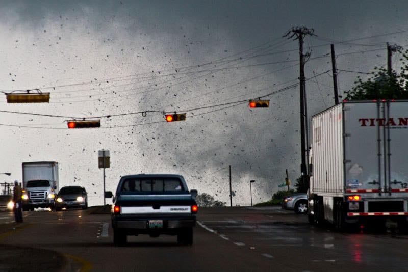 This photo was really forgotten because minutes later I took a photo that would make Time top ten photo of the year #humblebrag. I love the composition of this photo and the story it tells though. The vehicles that don't know a tornado is behind them. The man that's frozen in the middle of the road. Just enough debris coming from the tornado to know something powerful is over the hill. Lancaster, Texas. April 3, 2012.