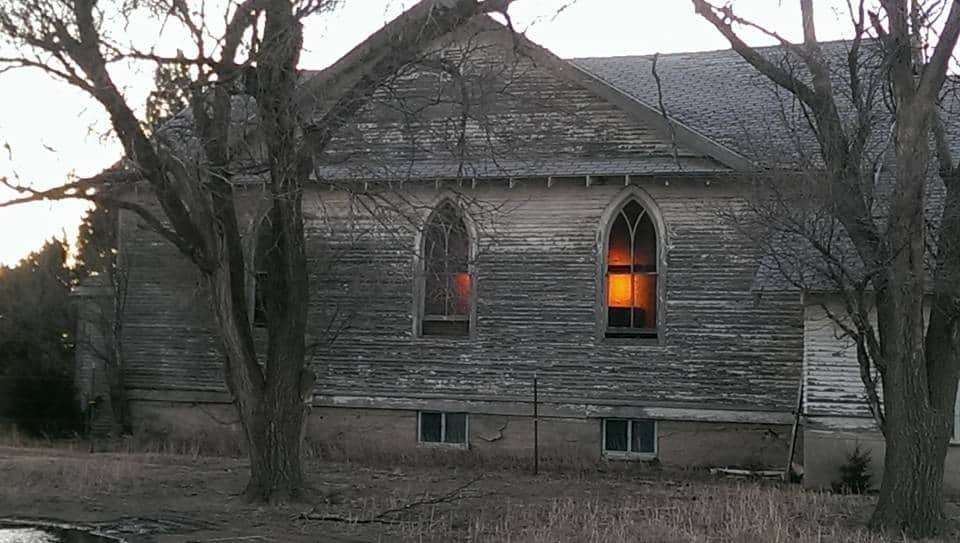 Caught the sun going down through the old church Windows.a little haunting,a lot beautiful.