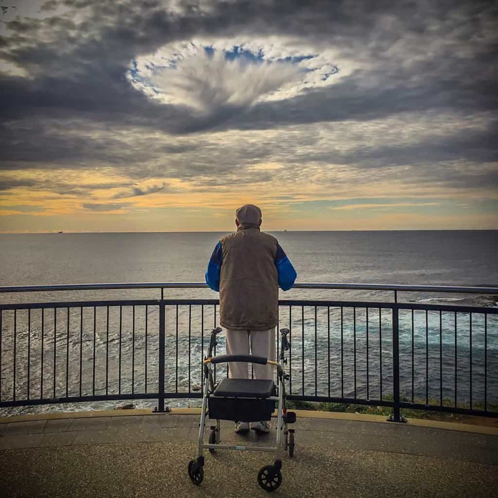 Some shots bring emotion out in me, I could not stop looking at this old chap wondering what he was thinking as the sky opened up in front of us. A portal for him perhaps! A penny for his thoughts  Wollongong Australia Iphone Shot-the best camera you have is the one in your pocket