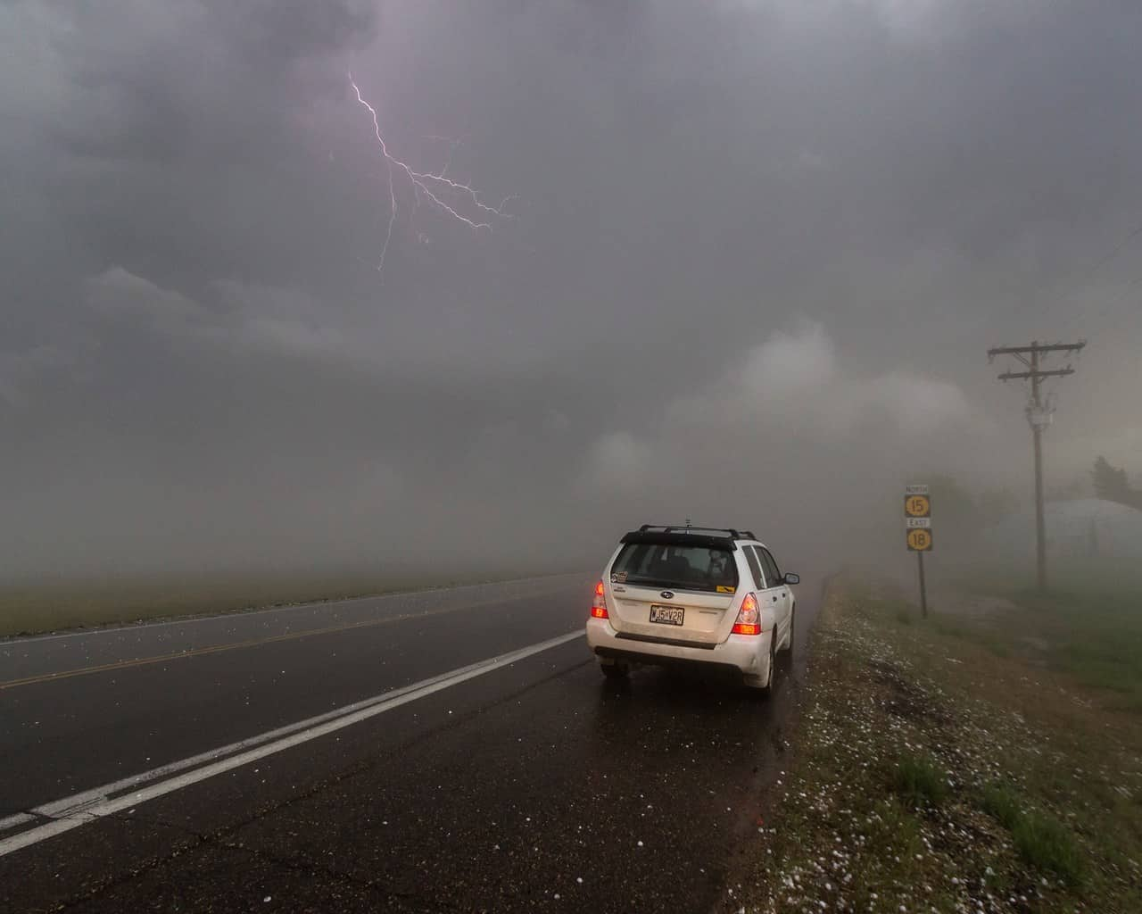 Snapped a quick picture of the hail fog back on the 24th of April, and a little bit of lightning managed to sneak into the shot.