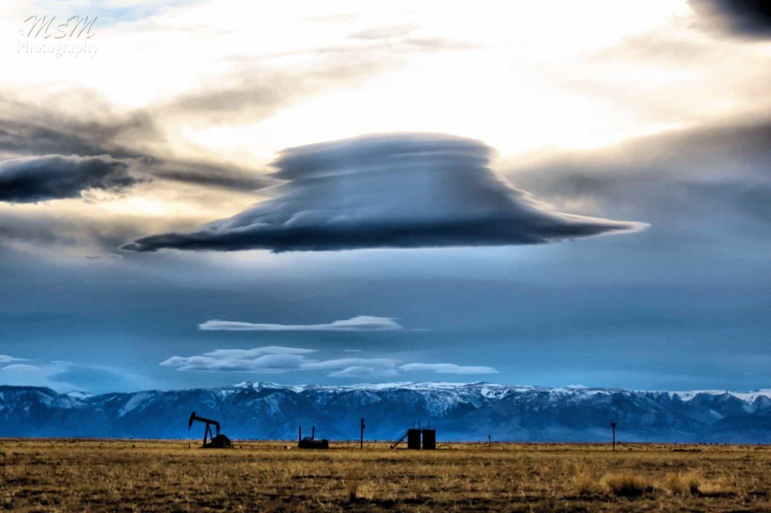 Unique looking lenticular cloud hovering over some of Wyoming's natural resources. Makes you wonder what is inside that cloud  Taken in March of 2015 north of Powell, WY.