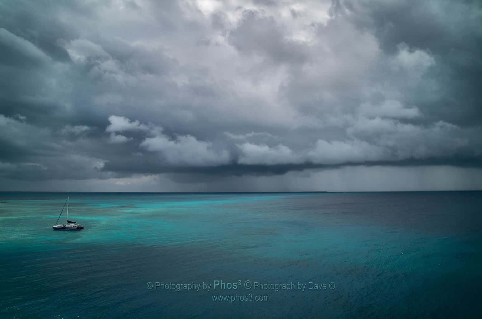 'Alone in the Storm, Even in Paradise Taken while on holidays as the Carnival Ecstasy was docking in the Turks and Caicos. I think we were the only ones that didn't mind the storms on this trip.