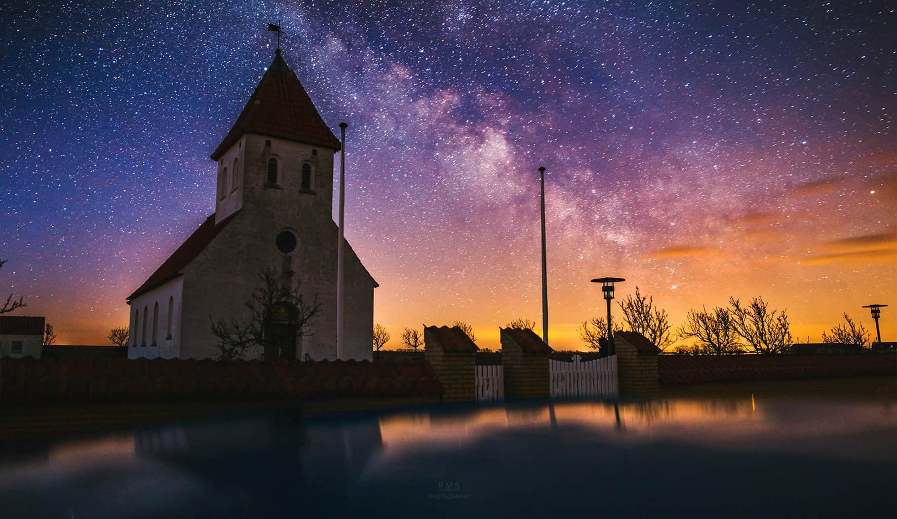 Agerø church and Milky Way taken from the car's rooftop.