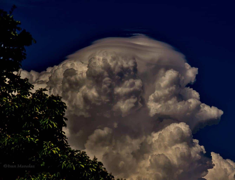 May 2016 Cumulonimbus calvus with impressive Pileus (cap cloud) over Sochi Russia.