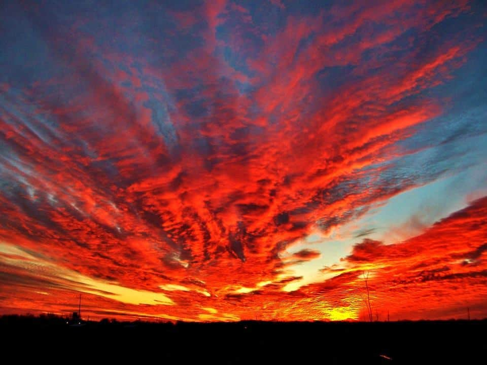 Just started taking pictures and I was standing in a muddy field in Bunker Hill Illinois. A red sunset. I will never forget