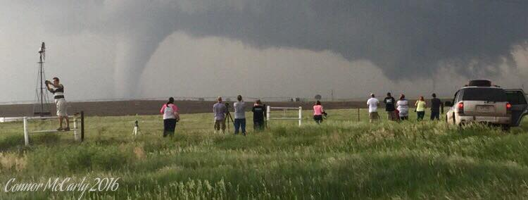 Fellow chasers watching a violent tornado head towards Dodge City, Kansas, this evening. During this tornado's life cycle, there were as many as 3 on the ground at the same time. Unreal day.