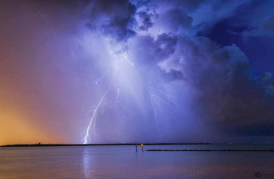 Lightning from a storm at the Sunshine Skyway Bridge in Florida Saturday night a little after sunset