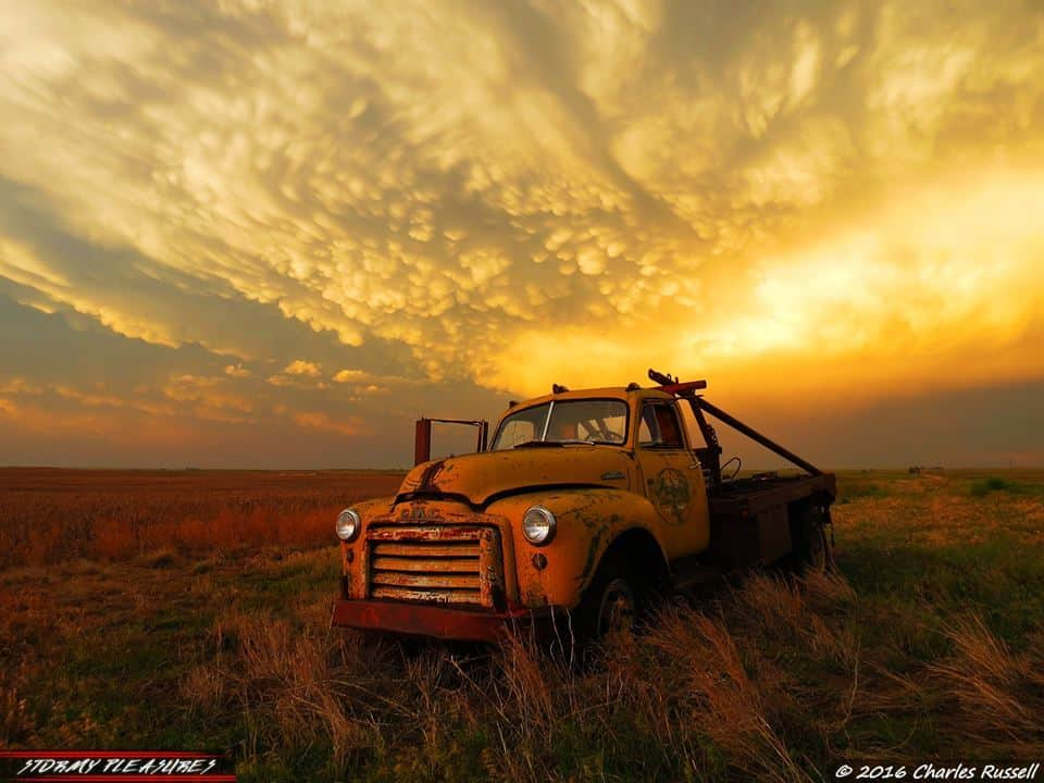 You guys want awesome? Chuck Russell will give you awesome! Check out this pic I snapped after the Dodge City, Kansas tornado outbreak! After the chase was over, the photo ops just kept rolling in. We were treated to this spectacular Mammatus display at sunset! Not only that, but the old dirt road we drove down just happened to have an abandoned GMC truck sitting right in a nearby field in the middle of nowhere. It was a surreal scene! Oh the stories that truck could tell. What a perfect end, to a perfect day