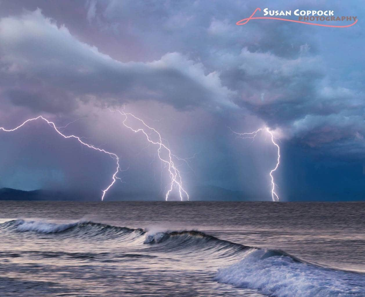This is a composite. I like how the three lightning strikes match the three tops of waves and how the sunrise colors fit together so well.