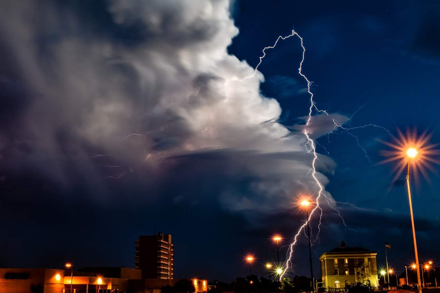 """Bolt from the Blue"" Captured 8/26/16 in downtown Lawton, Oklahoma. This is my favorite shot so far...I hope to catch more great opportunities during our upcoming storm season!"