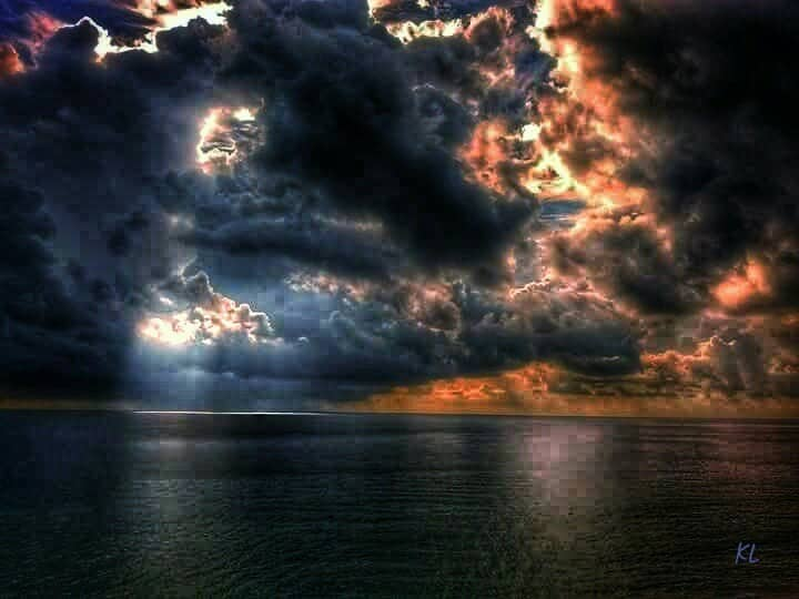 Sunrise, through storm clouds ~ Hollywood Beach, fl.