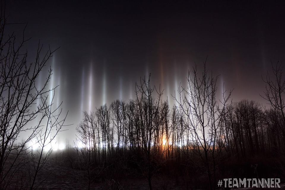 """""""Light Pillars"""" taken Dec 9/16 in Blackfalds Alberta. It was -28°C. A light pillar is an atmospheric optical phenomenon in the form of a vertical band of light which appears to extend above and/or below a light source. The effect is created by the reflection of light from numerous tiny ice crystals suspended in the atmosphere or clouds."""