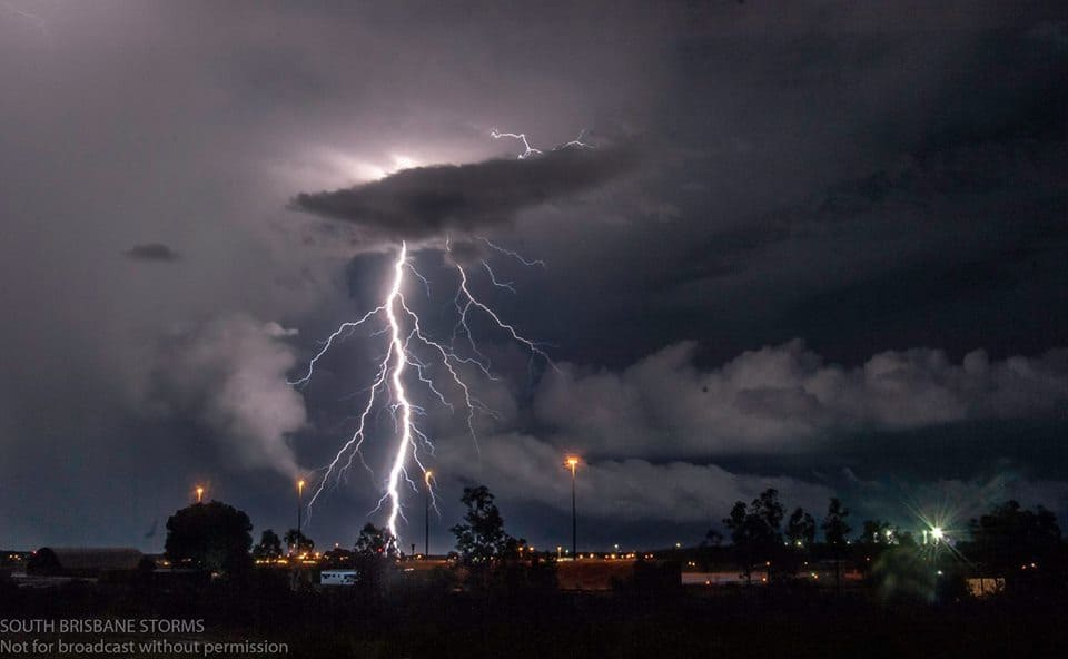 Lightning leaping out the back of a severe thunderstorm over Darwin Airport, Australia last night.