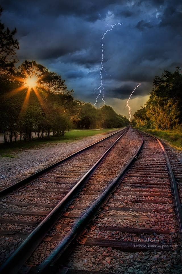 Electrified - a composite photo of my favorite train tracks and some lightning I captured from Tampa Bay.