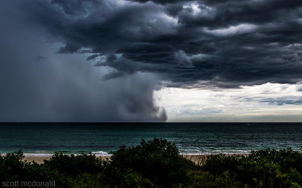 awesome thunderstorm building off the coast