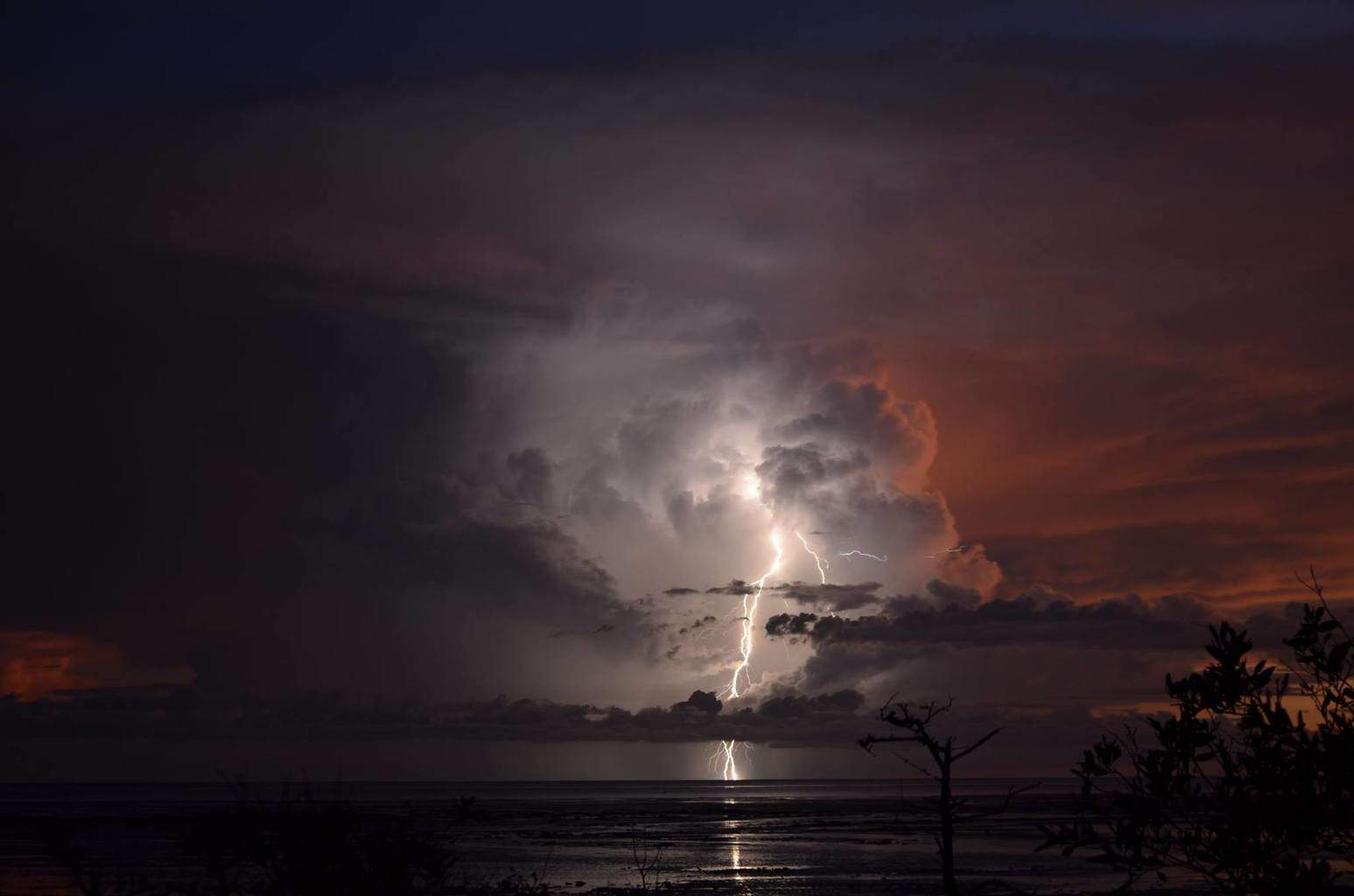 Roebuck Bay , Broome, Wetern Australia , just after sunset on the 15th March of a storm 120km to the south