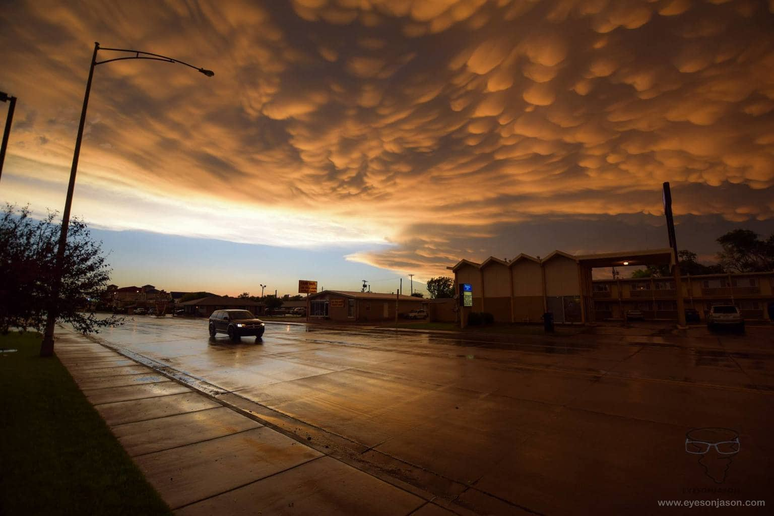 A mammatus sunset on a dramatic day chasing the Dodge City Storm on May 24th 2016. This was taken whilst waiting to enter a steak house, of which had suffered a power-outage from the storm. A video of our chase can be found on my website (in watermark) or on Youtube channel eyesonjason