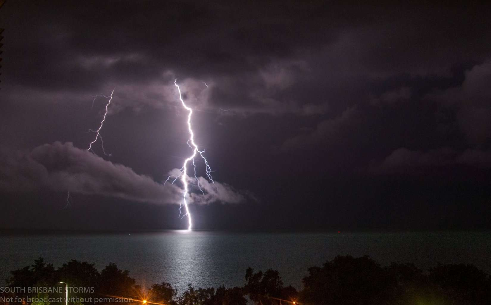 Lightning in Darwin, NT Australia this February as a close clear air strike hits the harbour.