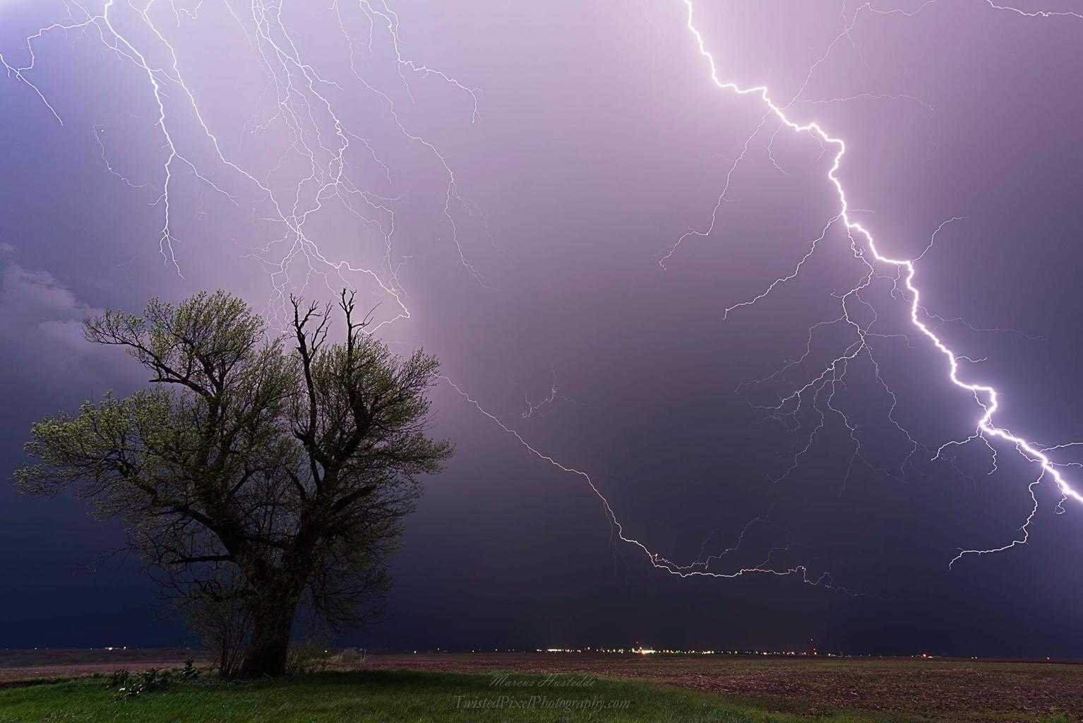 Leaders fill the sky over Hiawatha, KS last night as a CG strikes too close for comfort in the field next to me.
