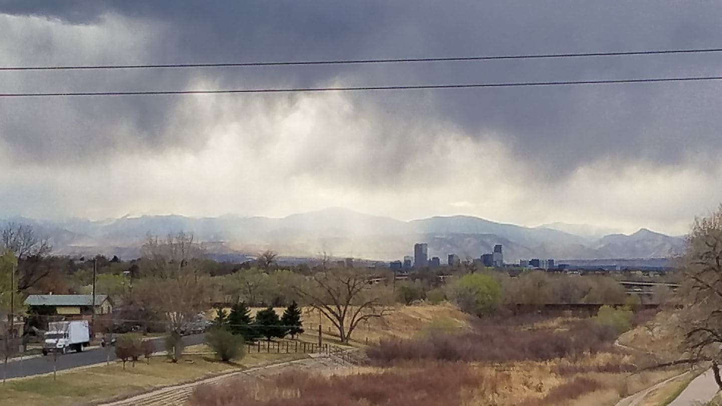 My home....this creek is where I grew up catching snakes, running from the police, etc etc ♡♡♡ Rain storm yesterday, snow today Aurora, Co 3/30/2017