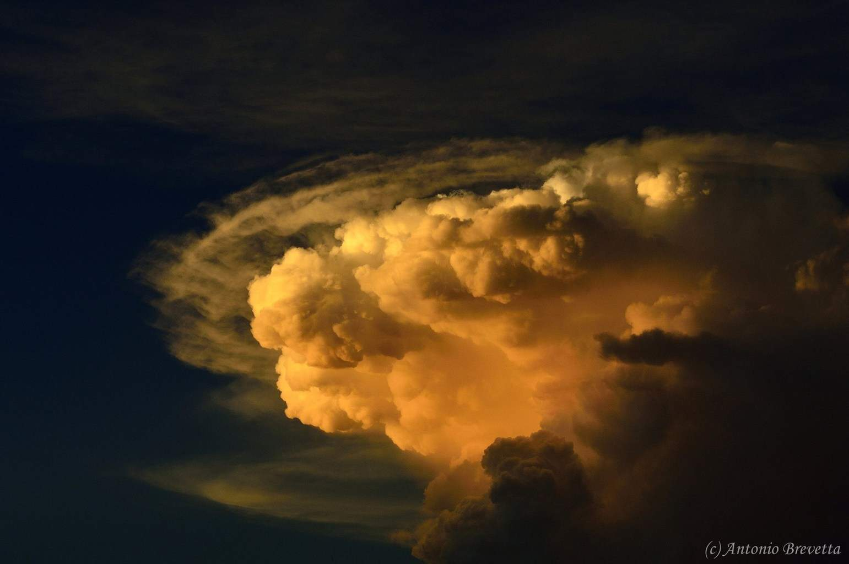 Top and anvil in a cumulunimbus cloud at sunset... Santiago del Estero, Argentina...