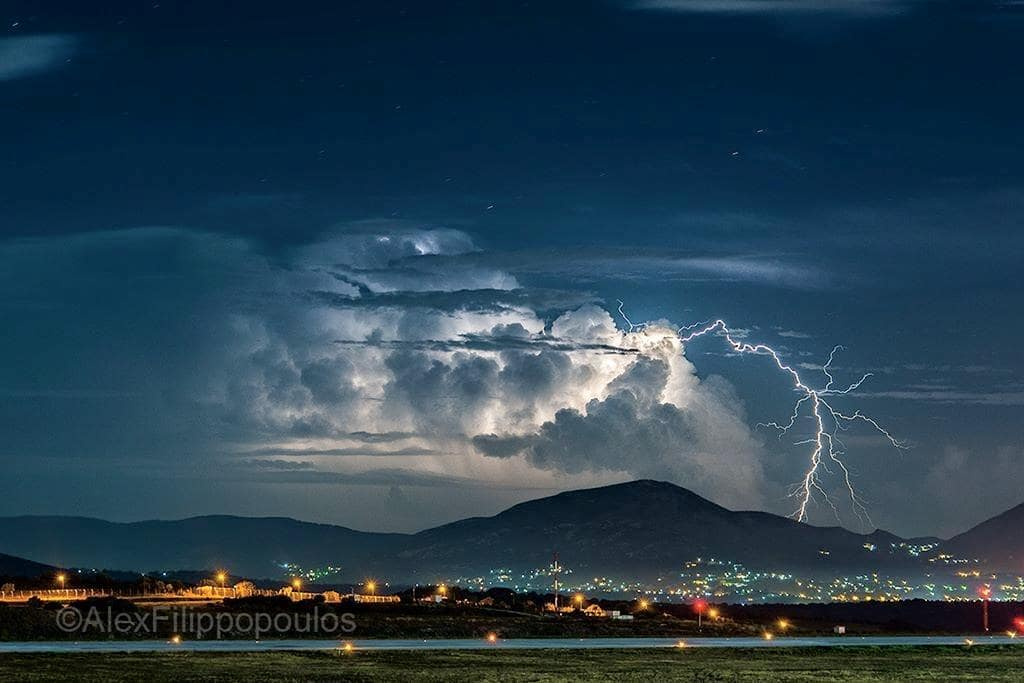 A beautiful and very active thunderstorm last September over the northwest Cyclades islands on the Aegean Sea, viewed from almost 100km away, and casting a massive positive bolt.