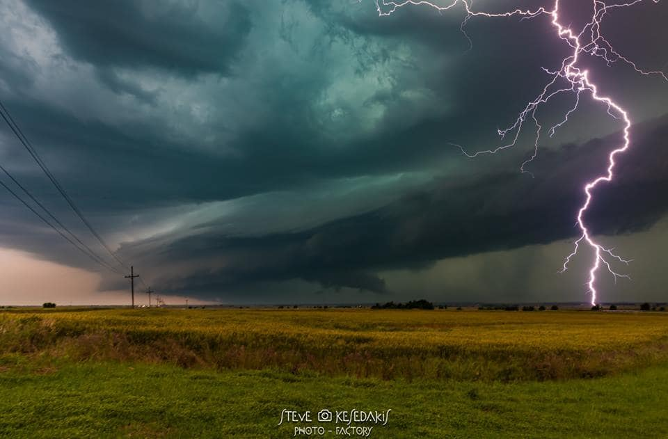 """Amazing almost nighttime supercell structure and lightning that illuminated the whole scene near Manchester Kansas on the 16th of May . This is actually the last shot i took that evening after a lot of almost boring :) strikes......so i call it my favorite """"lucky""""strike"""