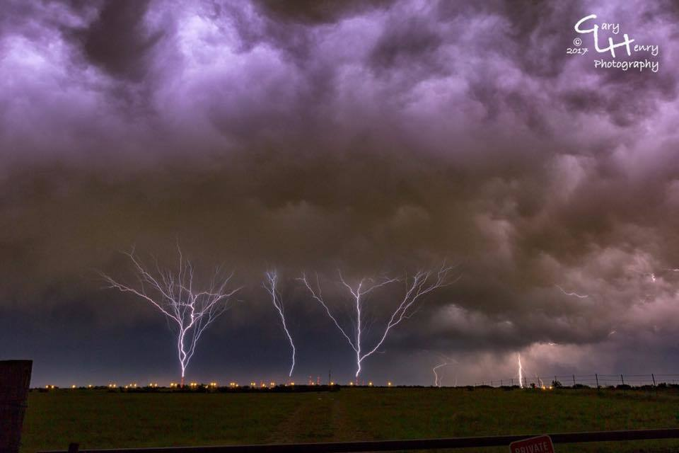 Ground to cloud, simultaneous triple strike. All three strikes emanate from television/radio towers in northeast Oklahoma City, OK. I was about 11 miles east of the tower farm when I shot this. This occurred during supercell activity over Oklahoma City.