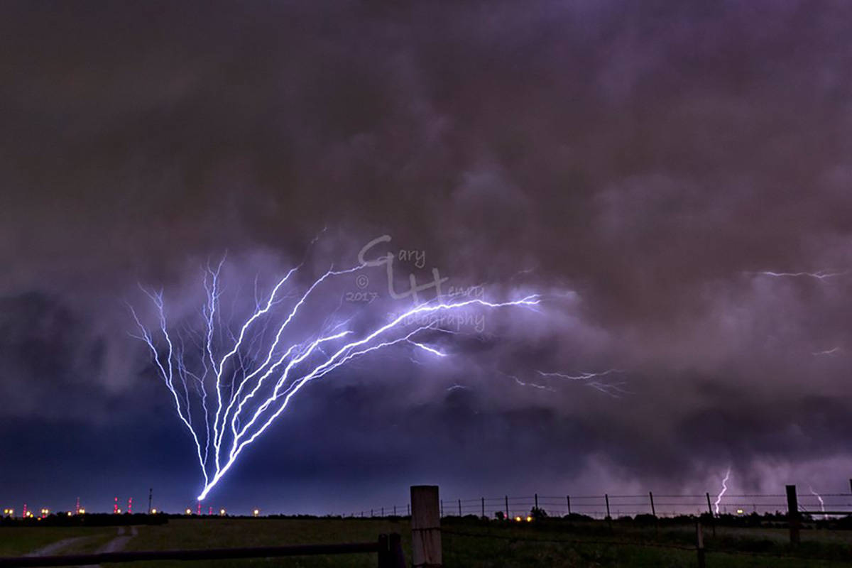 On Thursday night, May 18, I was out shooting as a super cell passed over the TV antenna farm in Oklahoma City. I was lucky enough to capture 5 different images of ground to cloud lightning that emanated from the TV towers. One of the shots was the pic I posted yesterday showing 3 simultaneous strikes. In addition to that one, I got 4 more. I didn't realize those towers were so reactive.
