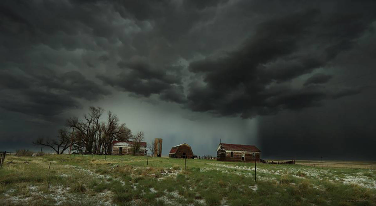 A storm that dropped torrential hail in the area looms over an abandoned farmhouse in Lowland, Colorado on the evening of 5-8-2017
